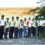 Official visit. Regional Director Carlos Tayag of MGB Ilocos Region (second from right) and his team, together with key TVIRD officers headed by Engr. Ely Valmores (in red, middle)  at the foot of the company's massive sulphide tailings facility. RD Tayag and his group composed of DENR, EMB and MGB officials, members of its Multi-Partite Monitoring Team and Northern Cement Corporation executives recently visited TVIRD's Canatuan mine site to see and learn from its best mining practices.