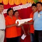 'We are eternally grateful.' Siocon Vice Mayor Nathaniel Usin and Bulacan Barangay Captain Corazon Molina (far Left and Right, respectively) receive the ceremonial key to their new barangay health center from TVIRD Mill Operations Manager Engr. Rey Carubio.  TVIRD supported the construction of the new facility, including those of Barangays Tibangao and S. Cabral.