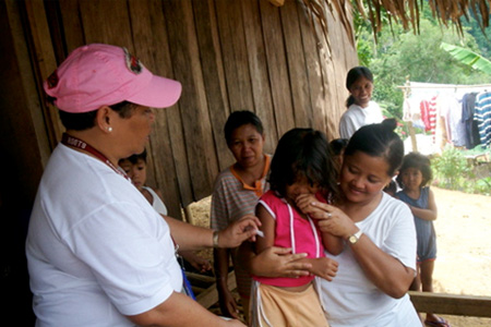 Members of the TVIRD medical team go to children and adults in far-flung rural areas to provide free vaccines during the anti-measles campaign.